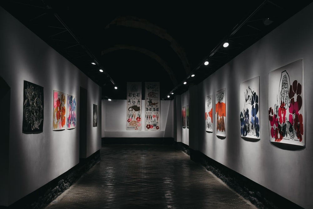 empty hallway with paintings on the wall