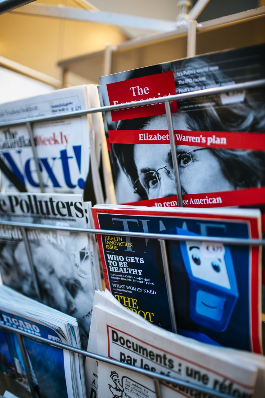 magazines displayed on a rack