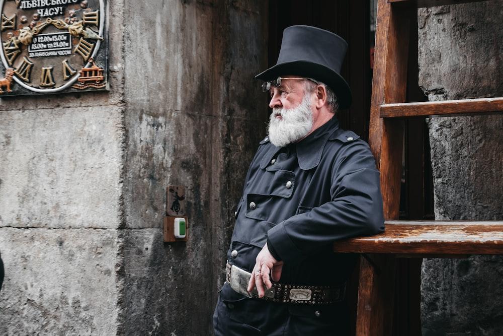 man standing beside stairs