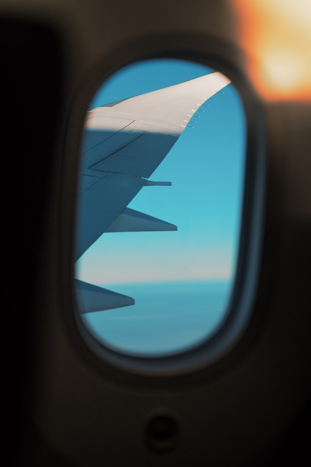 airliner window photography of wing
