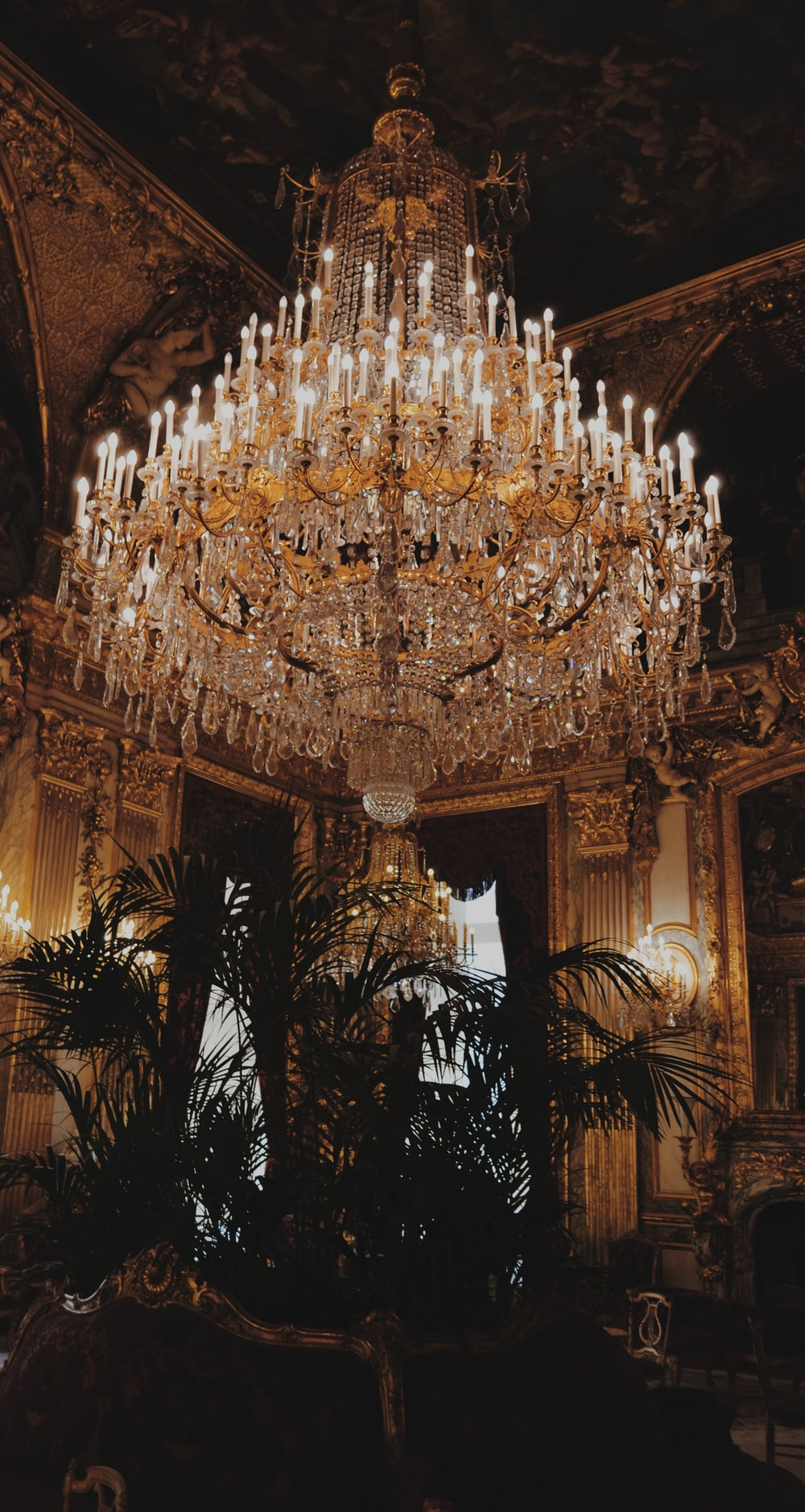 white and gold-colored chandelier