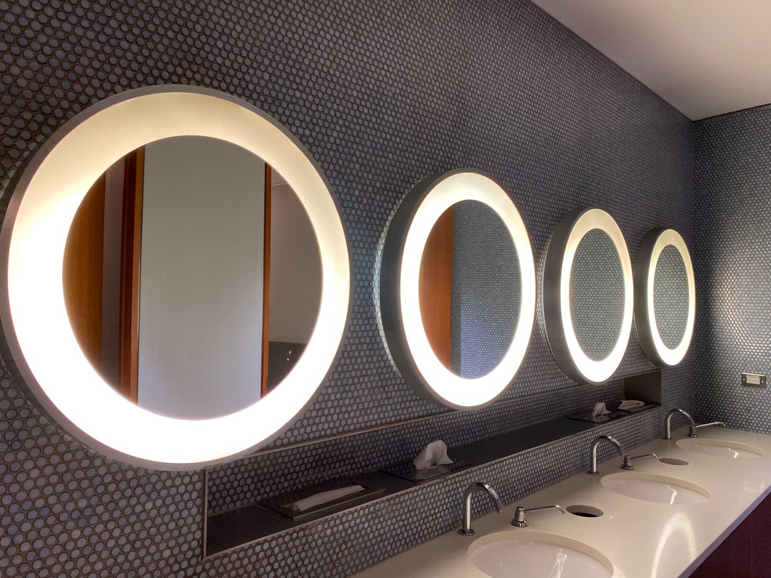 Mirrors and sinks in the Men's washroom of the Maple Leaf Lounge of Pearson International Airport