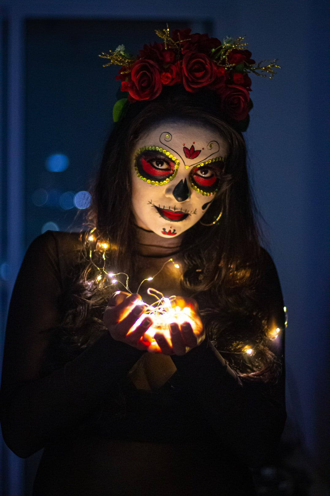 Woman with lights and spooky make-up for halloween