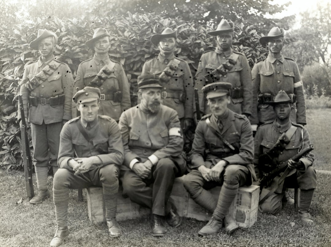 World War 1. Group of six officers & men 1/4th Gurkhas who have received honours or been mentioned in dispatches in this war, with a French Red Cross surgeon who was till recently a prisoner in German. Photographer: H. D. Girdwood.