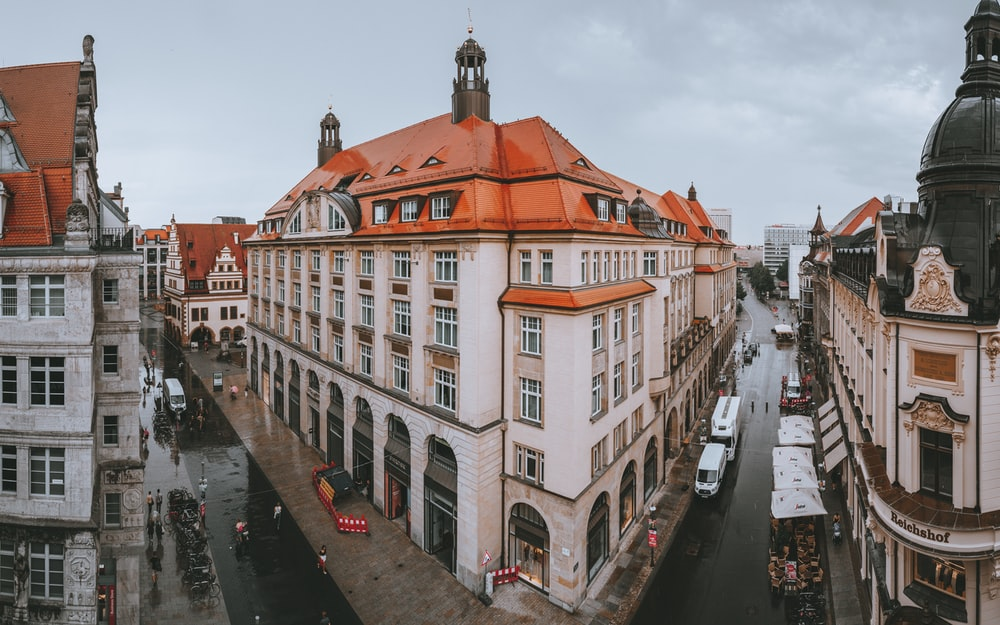 high-angle photography of white and red concrete building