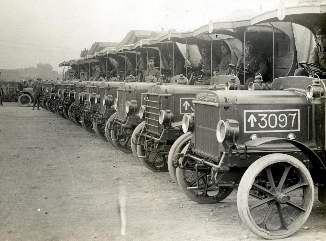 World War 1. Supply column waiting to load at a railway station.