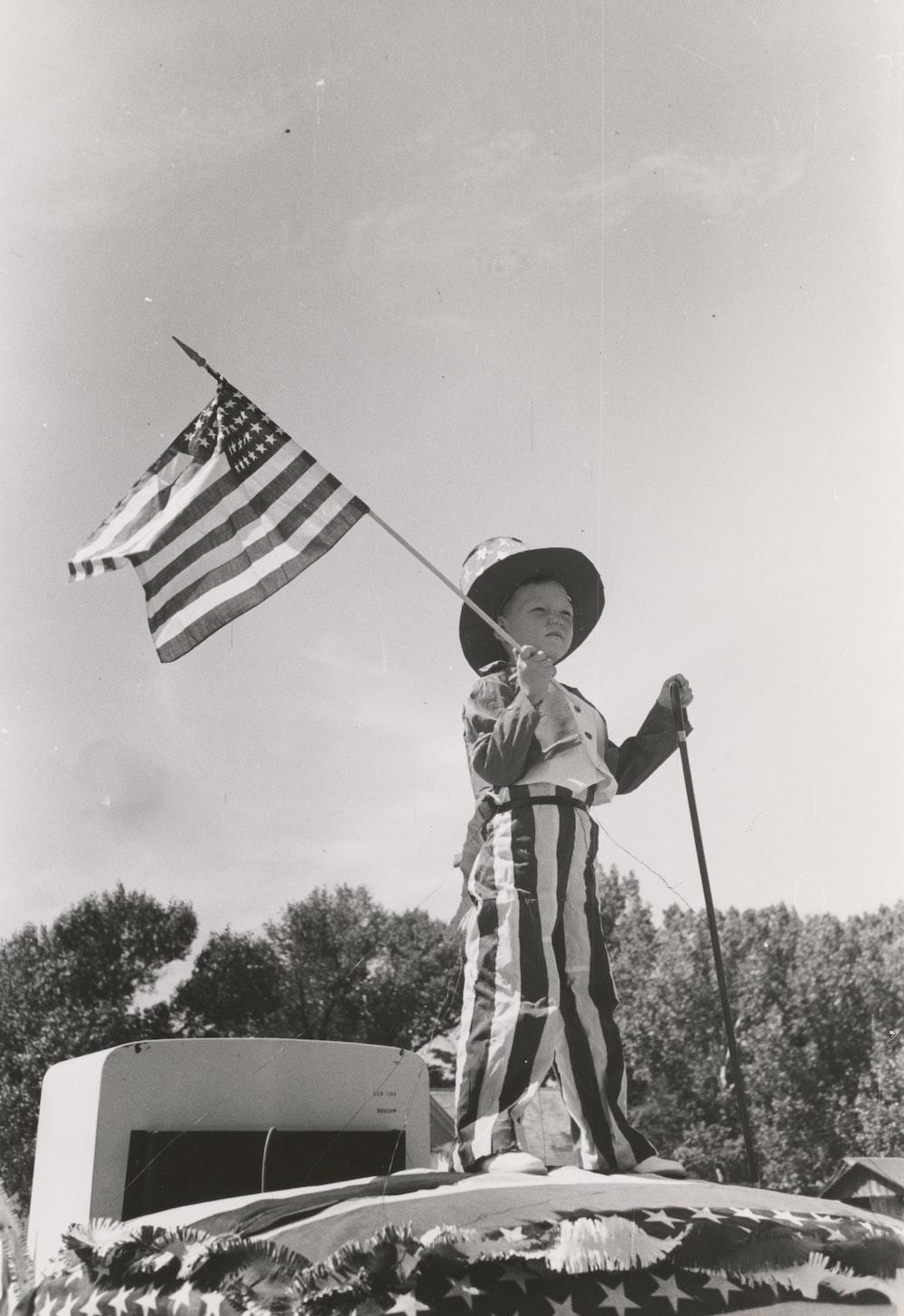 boy holding US flag