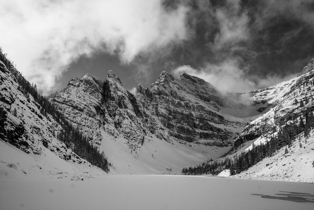 grayscale photo of hill covered with snow