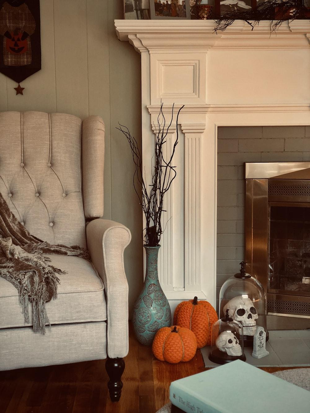 pumpkins and skull decors near fireplace