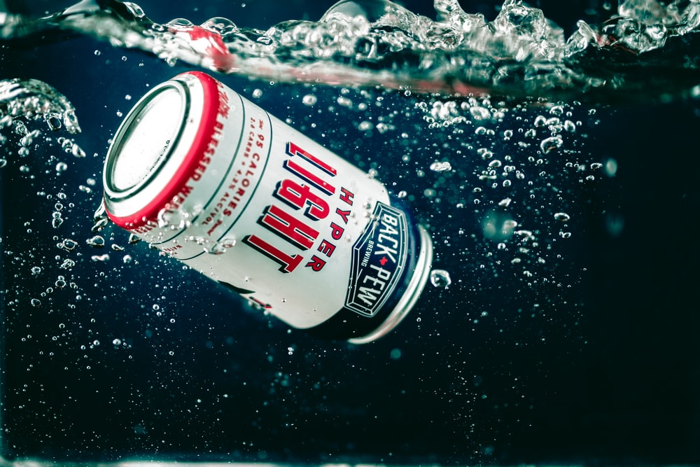 Hyper Light beer can under water
