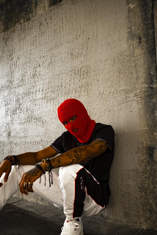 man wearing black shirt and red mask