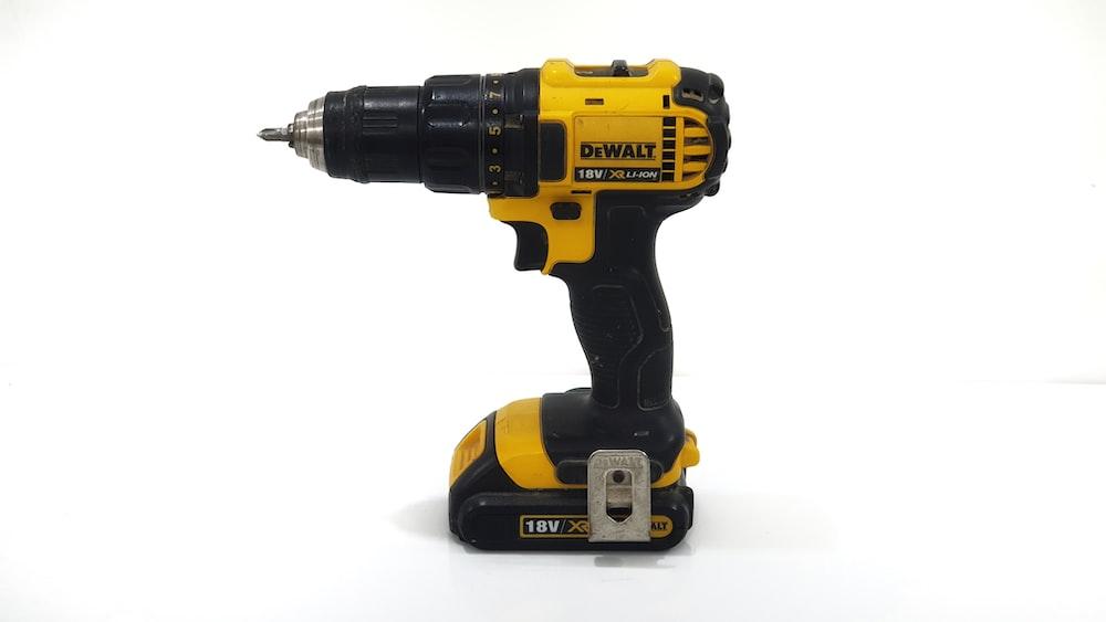 black and yellow DEWALT cordless drill