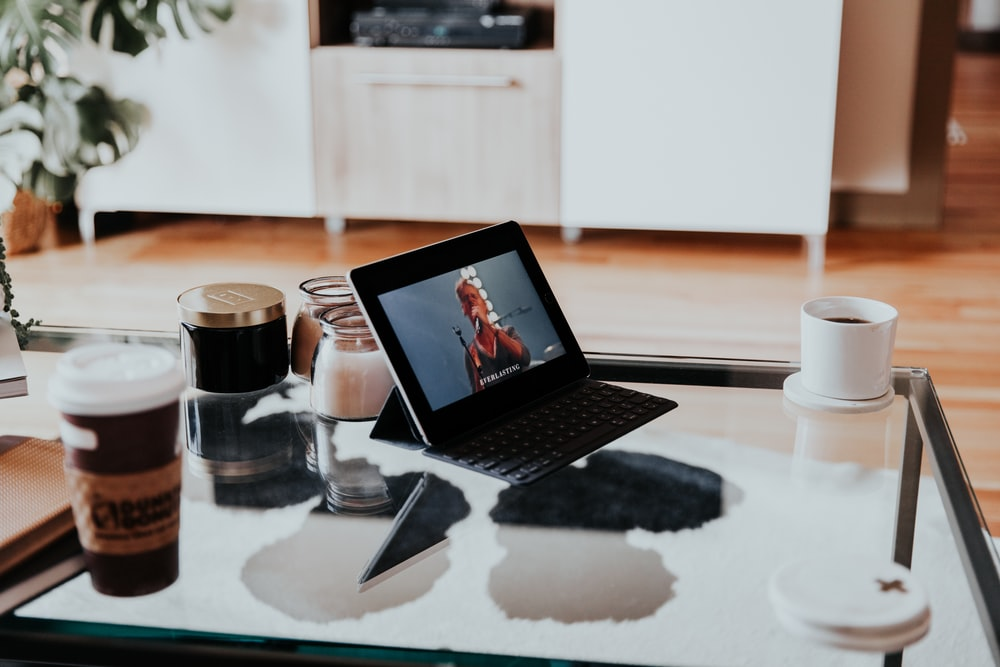 black tablet computer on top of table