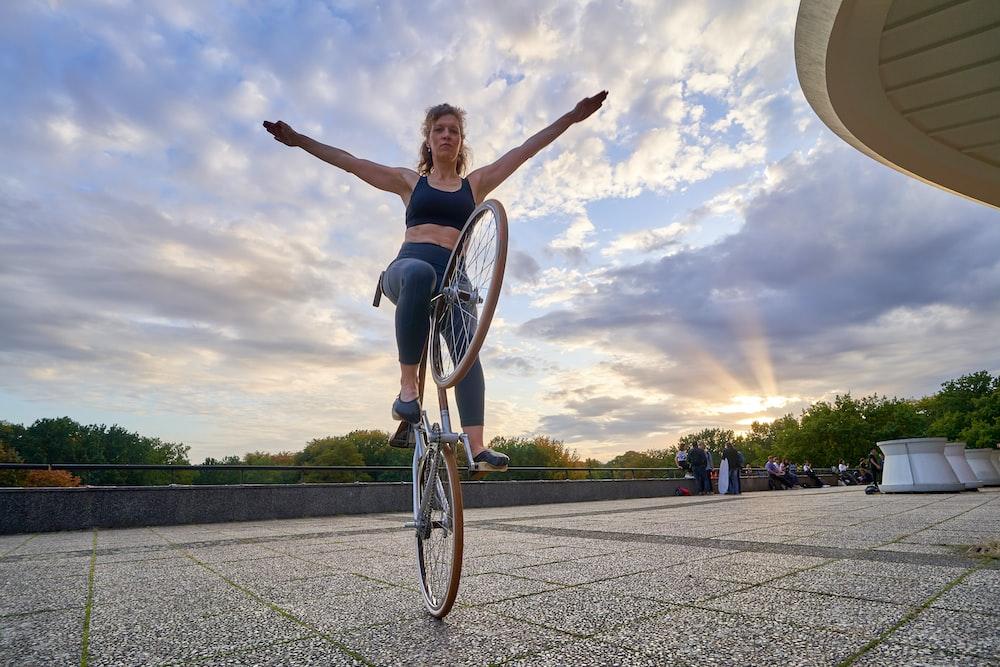 woman riding bicycle during daytime