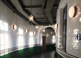 empty hallway with turned-on lights on the wall