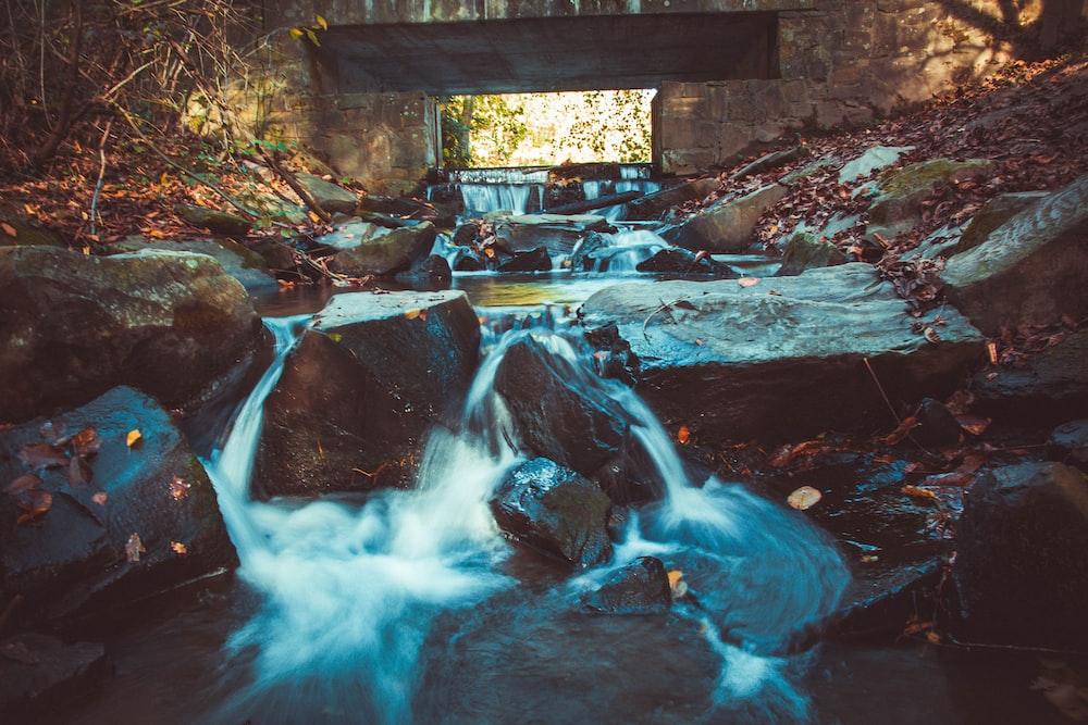 water stream under bridge