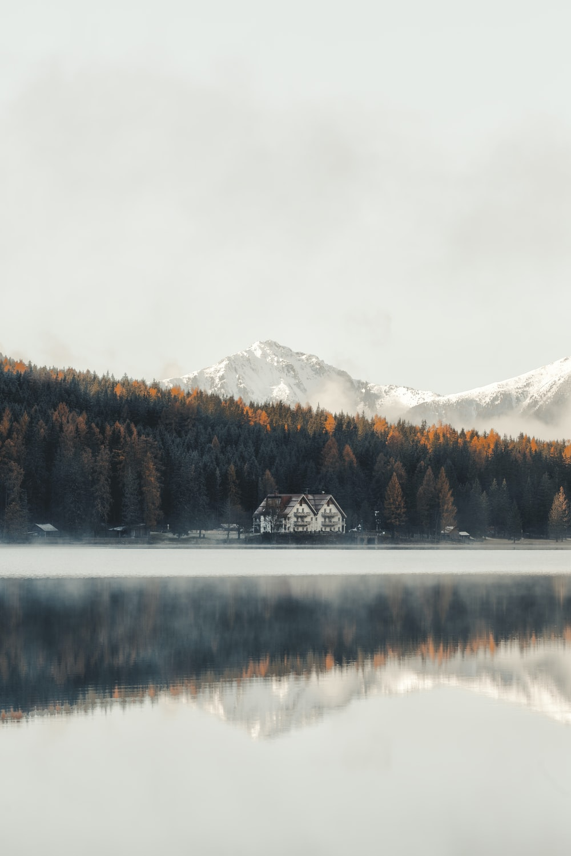 white and brown house near at lake