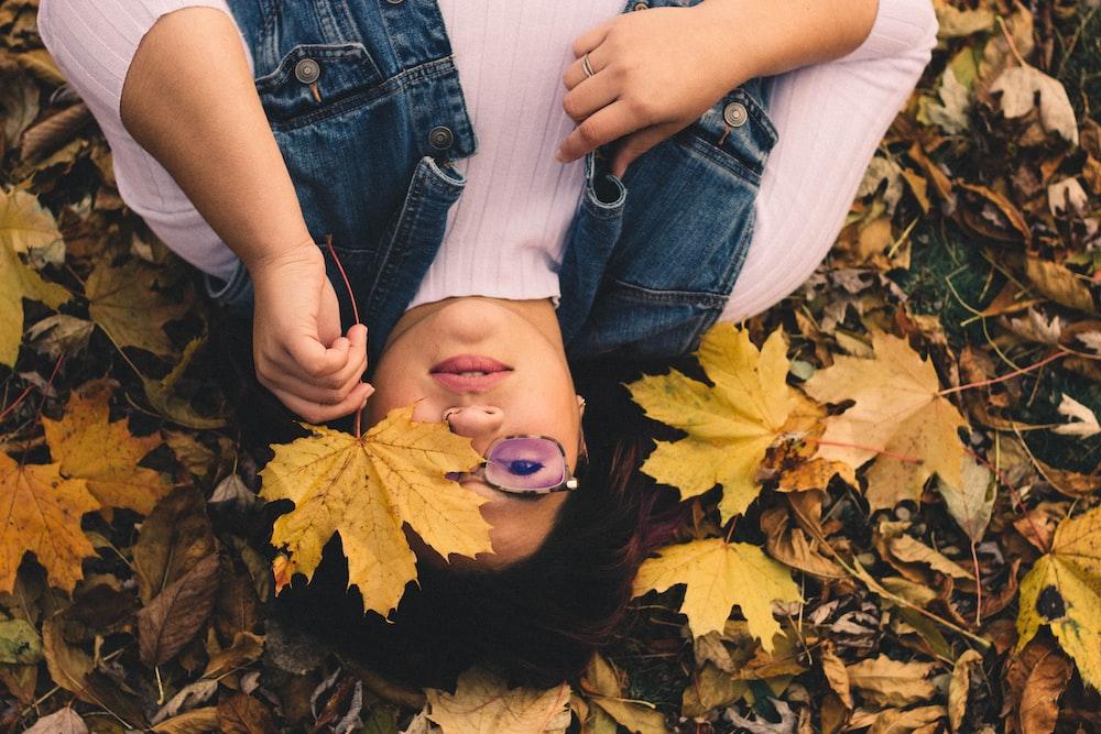 woman lying on maple leaf lot