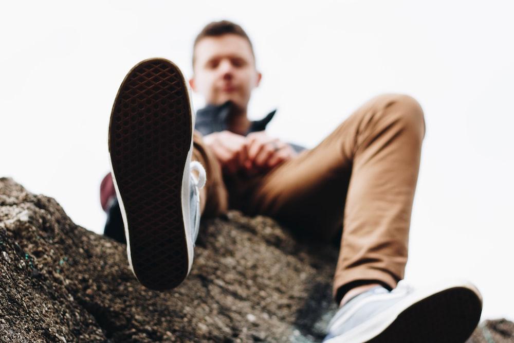 man wearing brown jeans