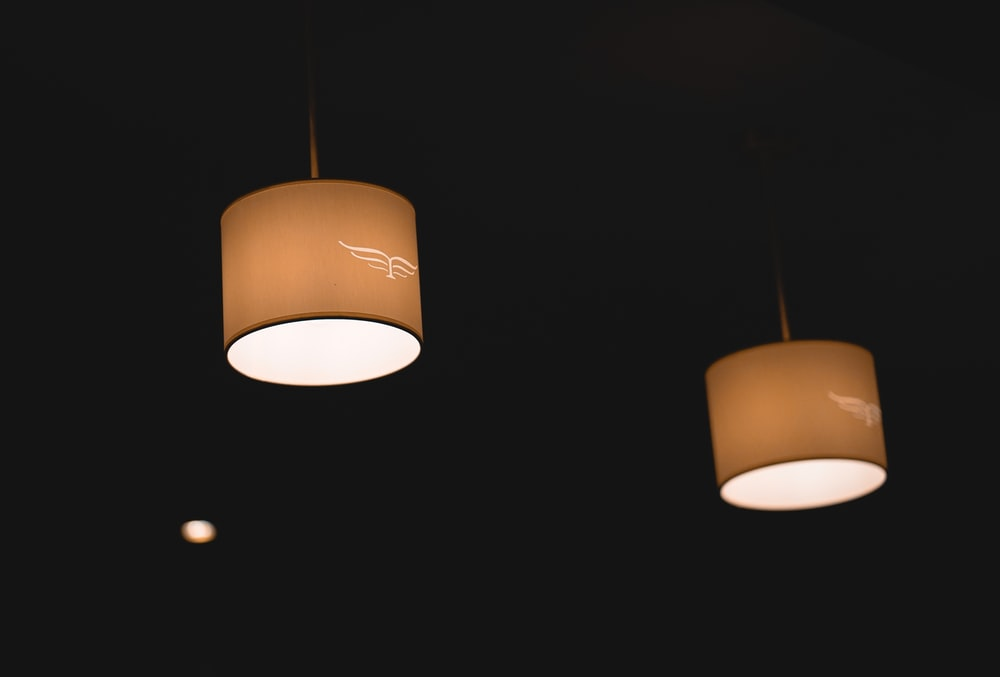 two beige pendant lamps