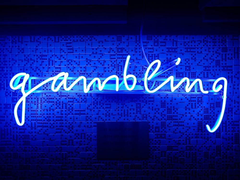 blue gambling neon signage