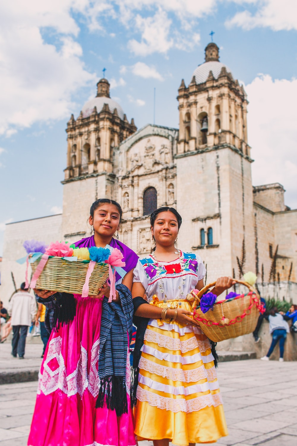 two woman carrying baskets