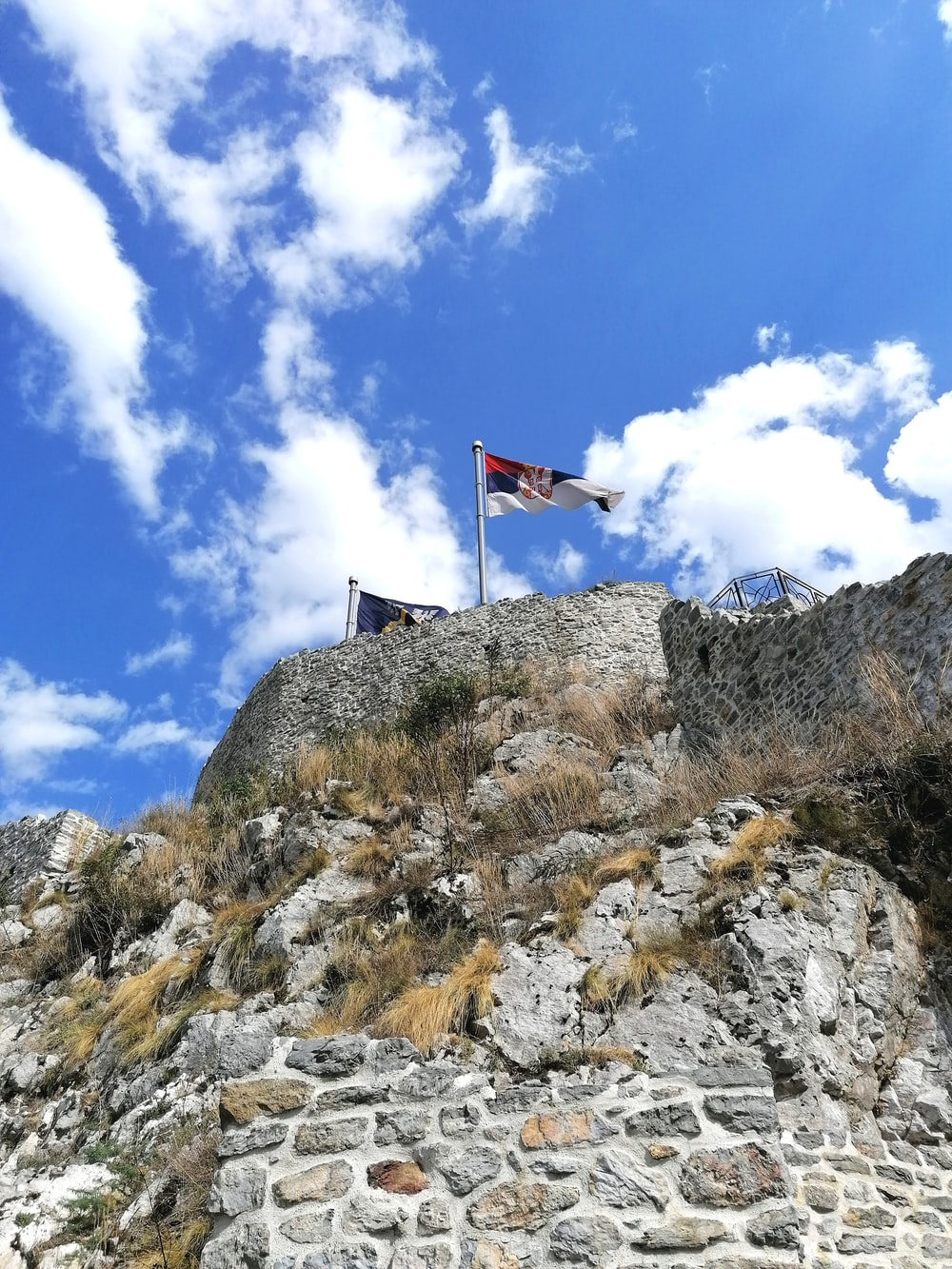 flag on top of rock formation