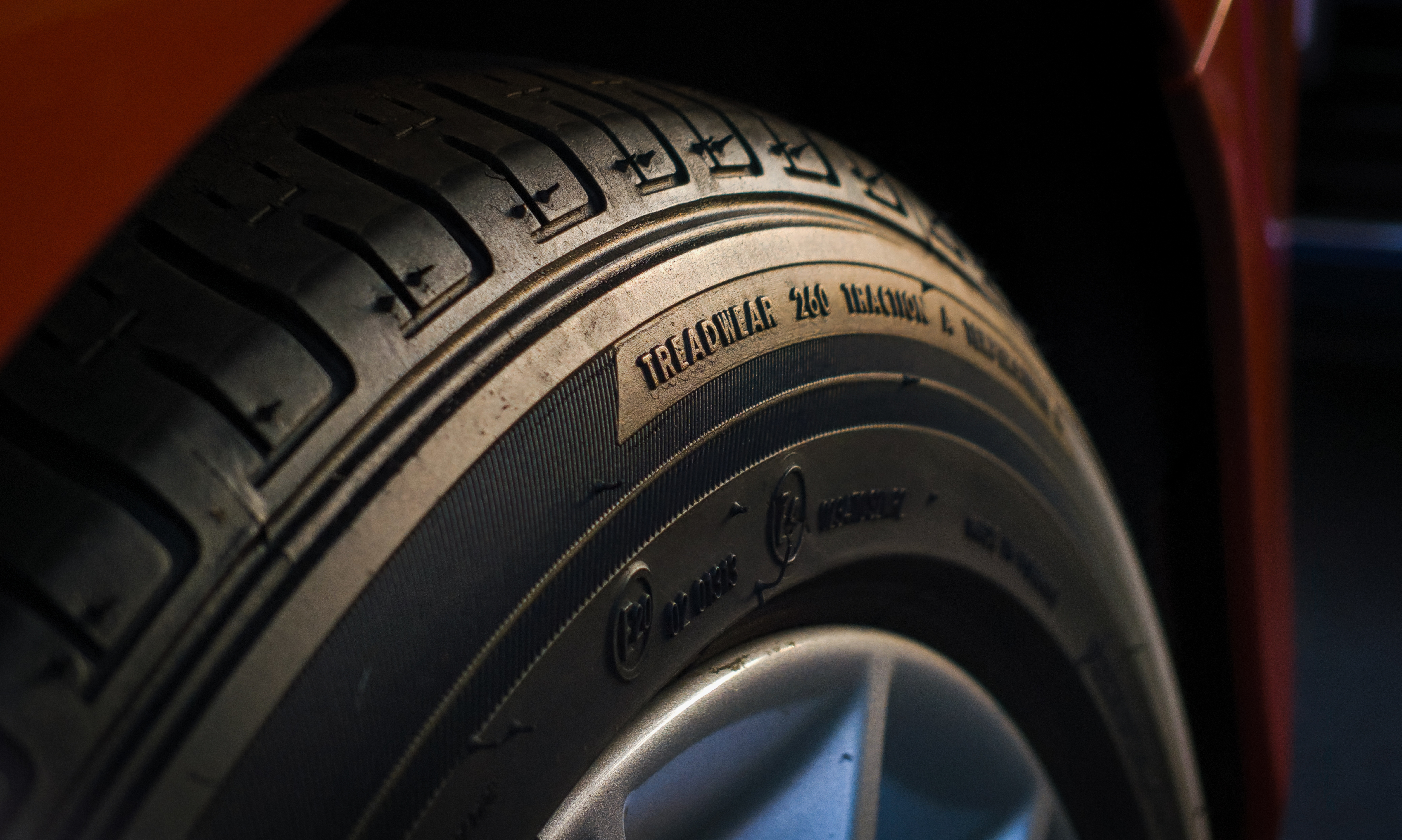 High End rubber tire closeup during sunset, focused on the typography.