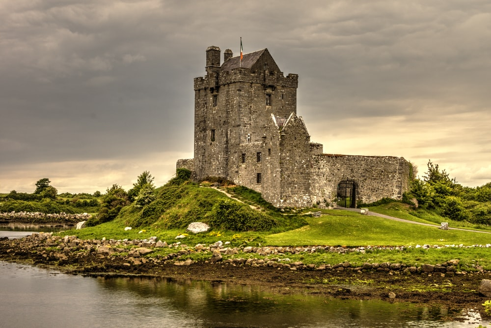 view photography of gray castle on island