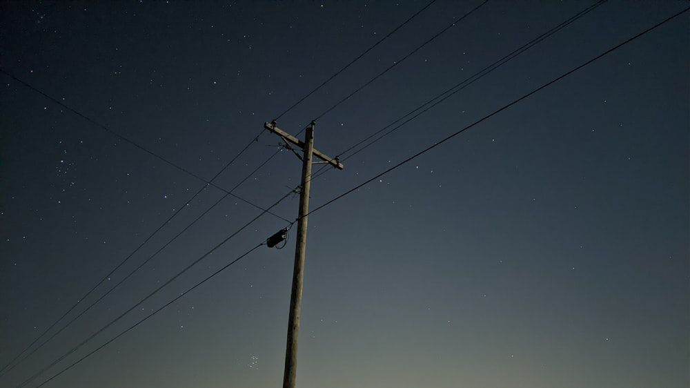silhouette of electric post