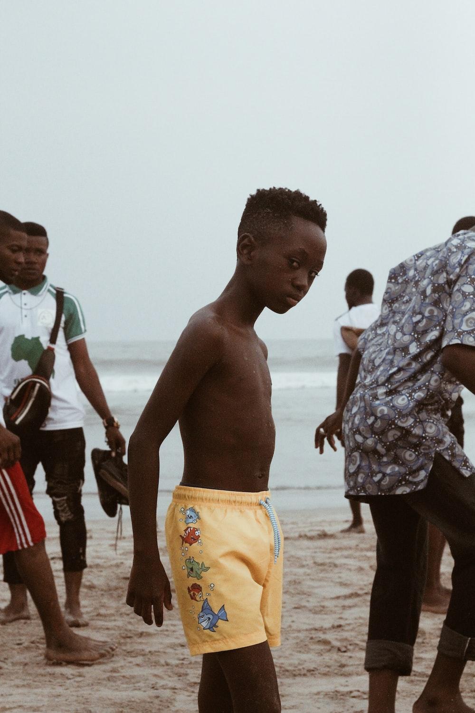 topless boy at beach