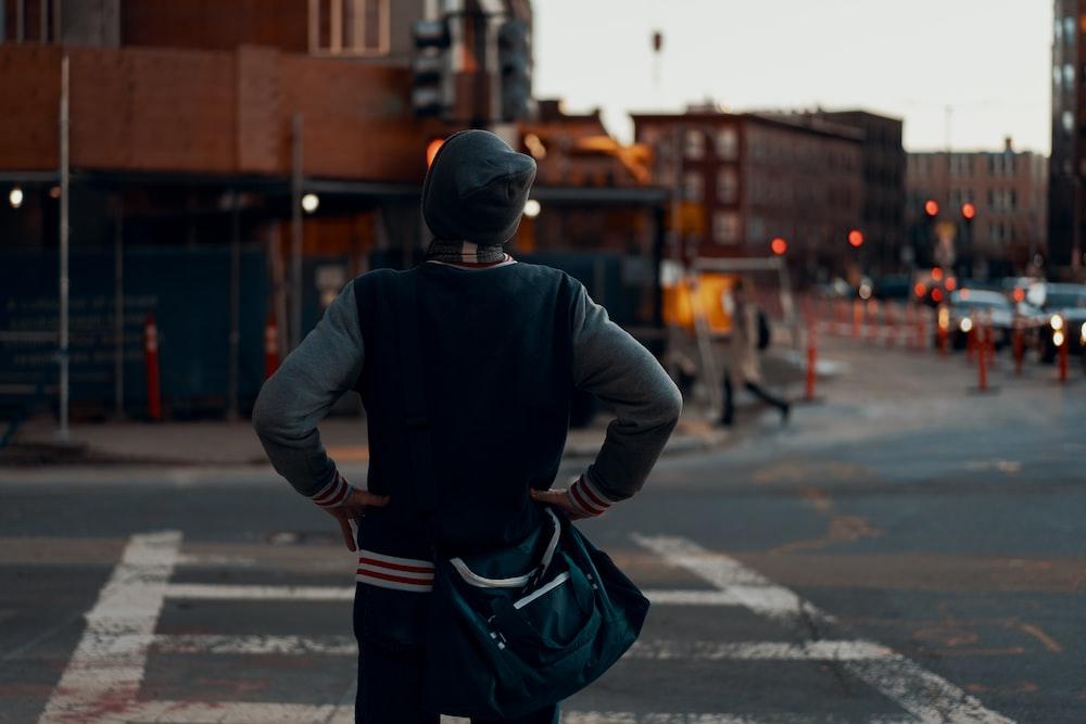 man standing near pedestrian lane