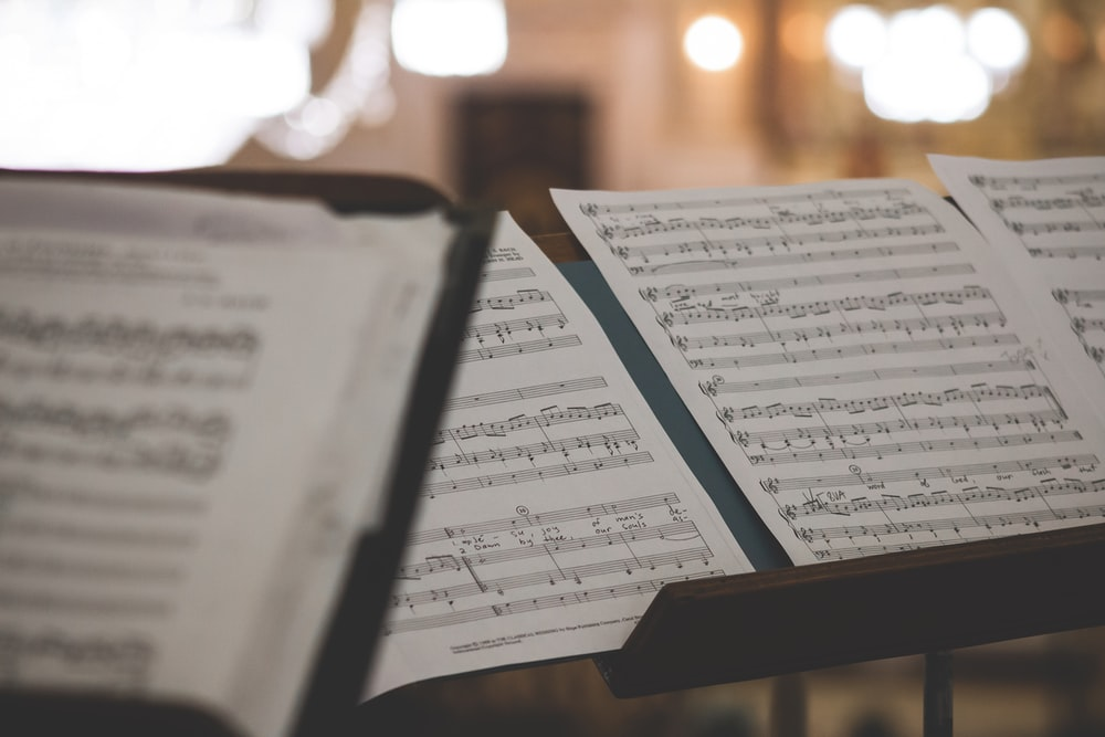 closeup photo of printer paper with musical notes