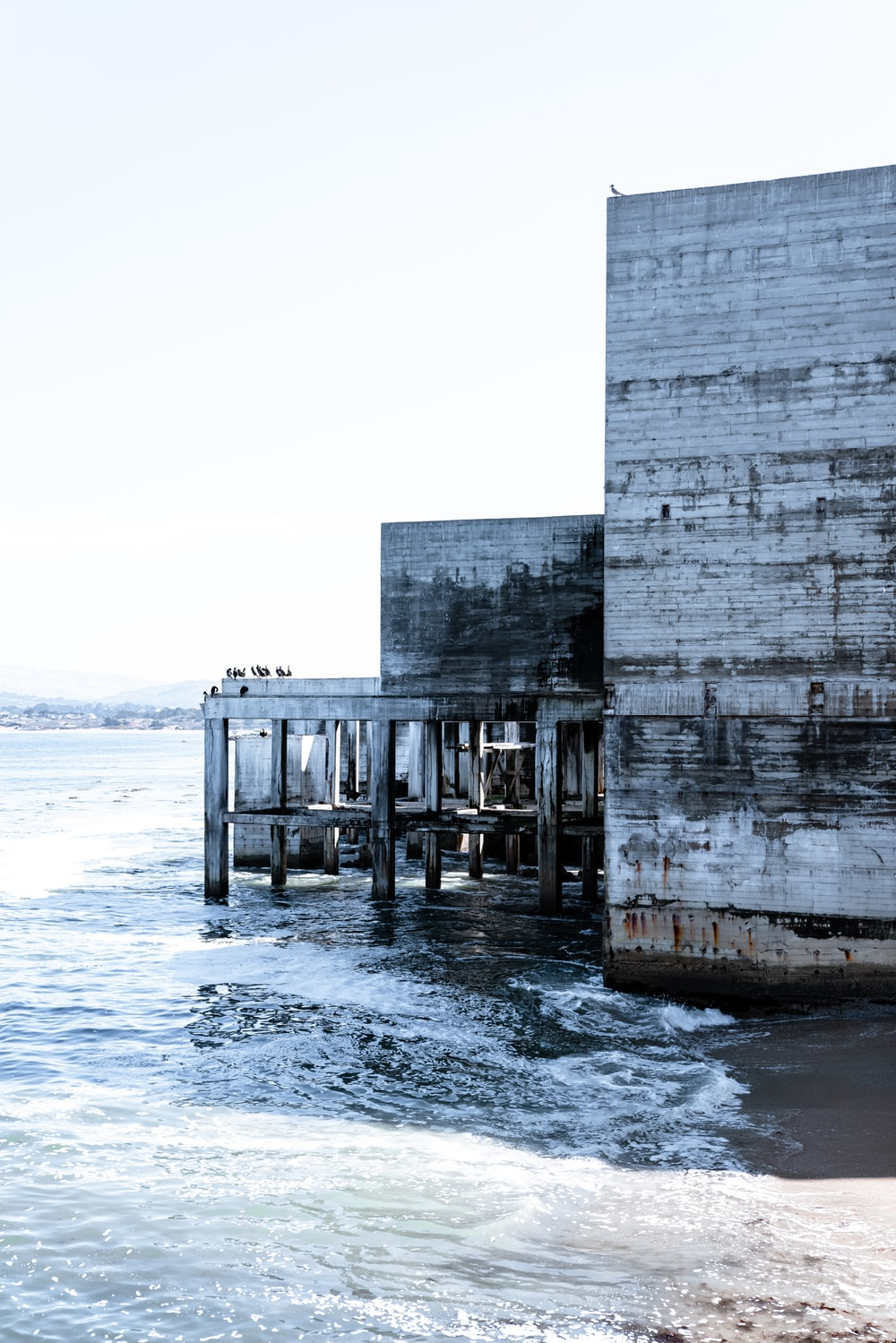 gray concrete building by the beach