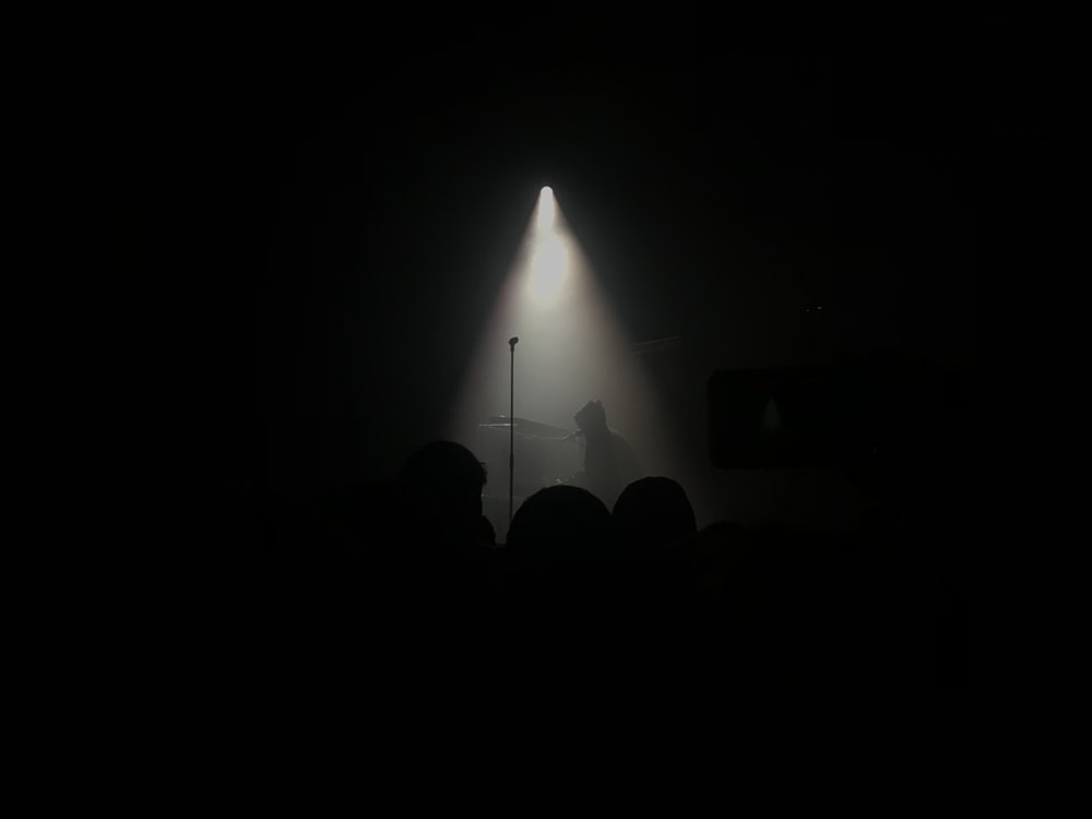 silhouette of person performing on stage