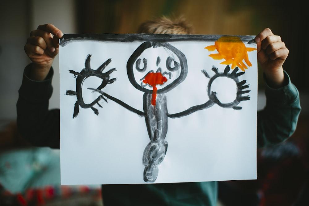 toddler holding drawing