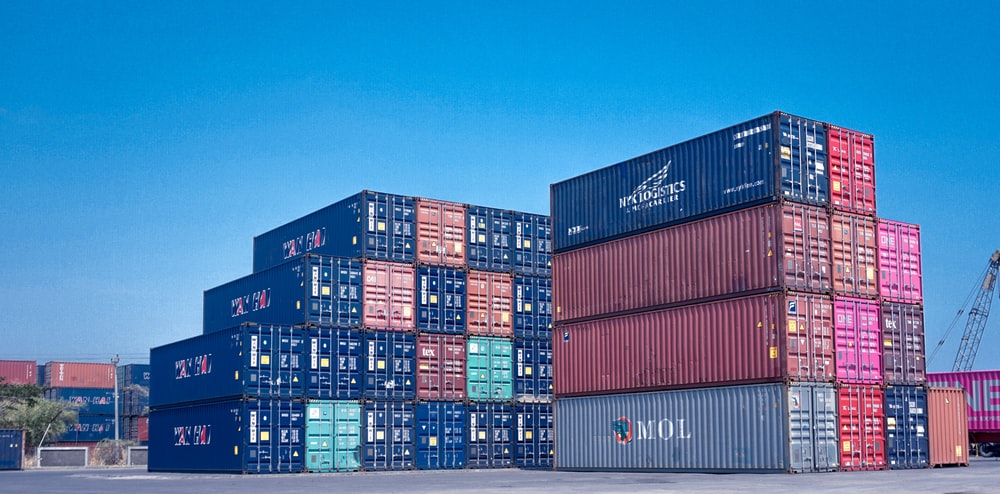 architectural photography of cargo containers stack