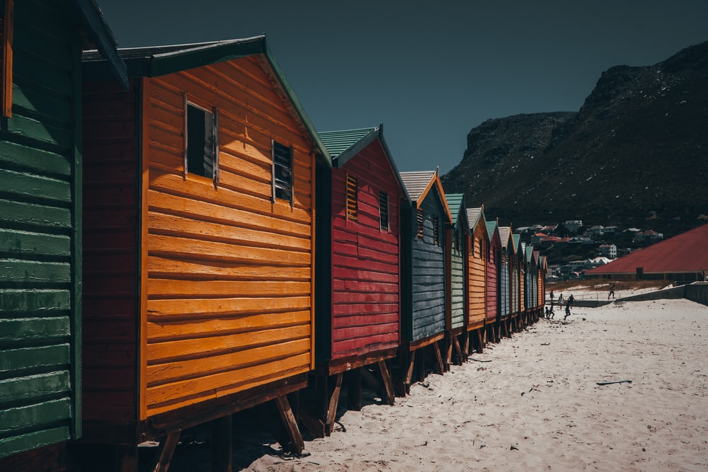 architectural photography of yellow, red, blue, and green wooden houses