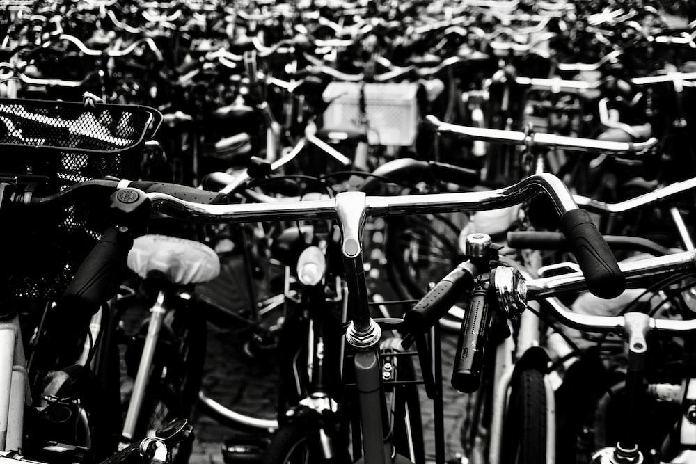 grayscale photo of bikes