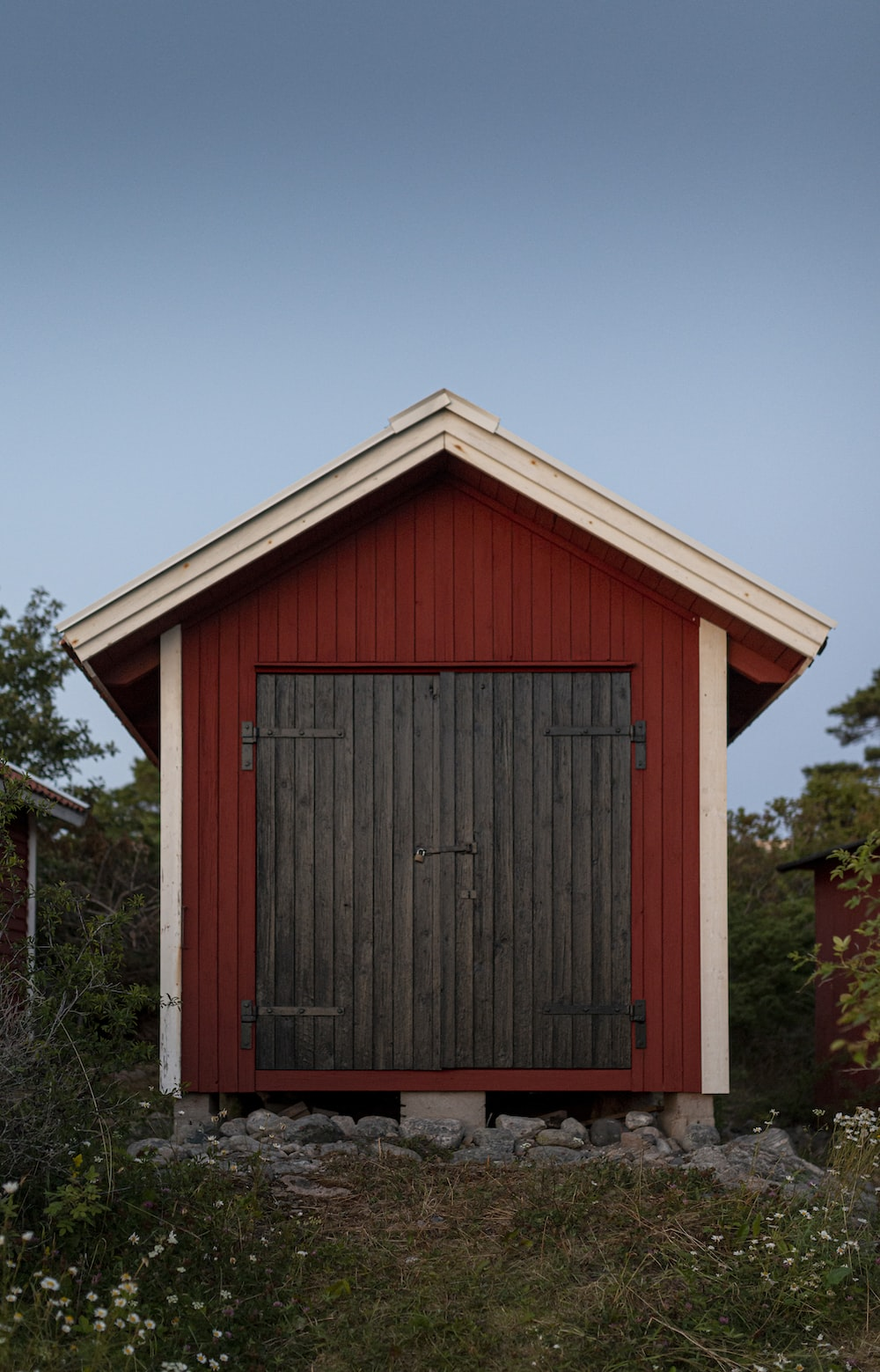red wooden house near tree