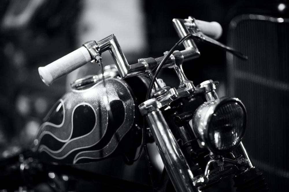 black standard motorcycle grayscale photo