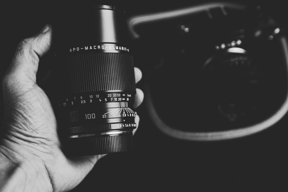 greyscale photography of black camera lens