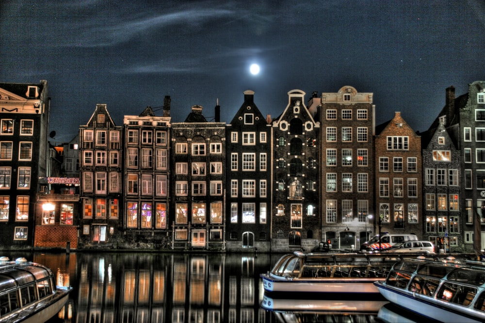 panoramic photography of buildings beside river