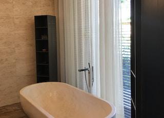 white porcelain tub on a bathroom