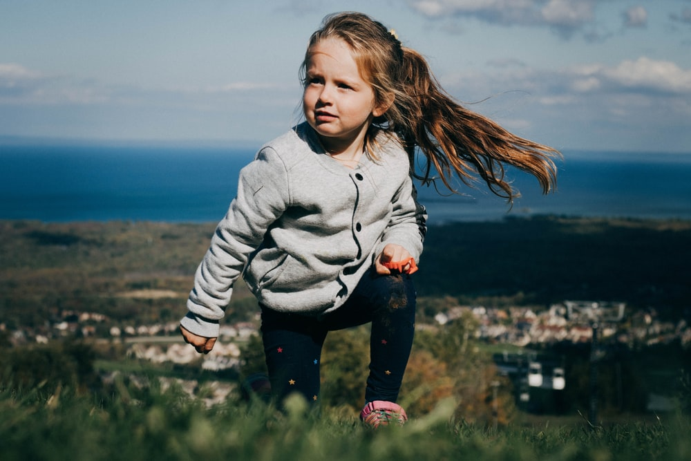 girl climbing on mountain