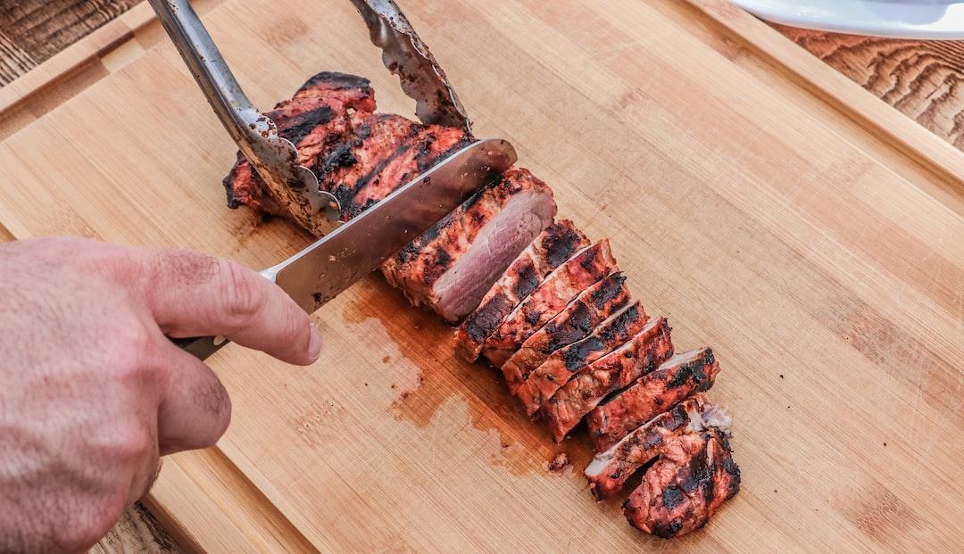 Man slicing grilled pork loin
