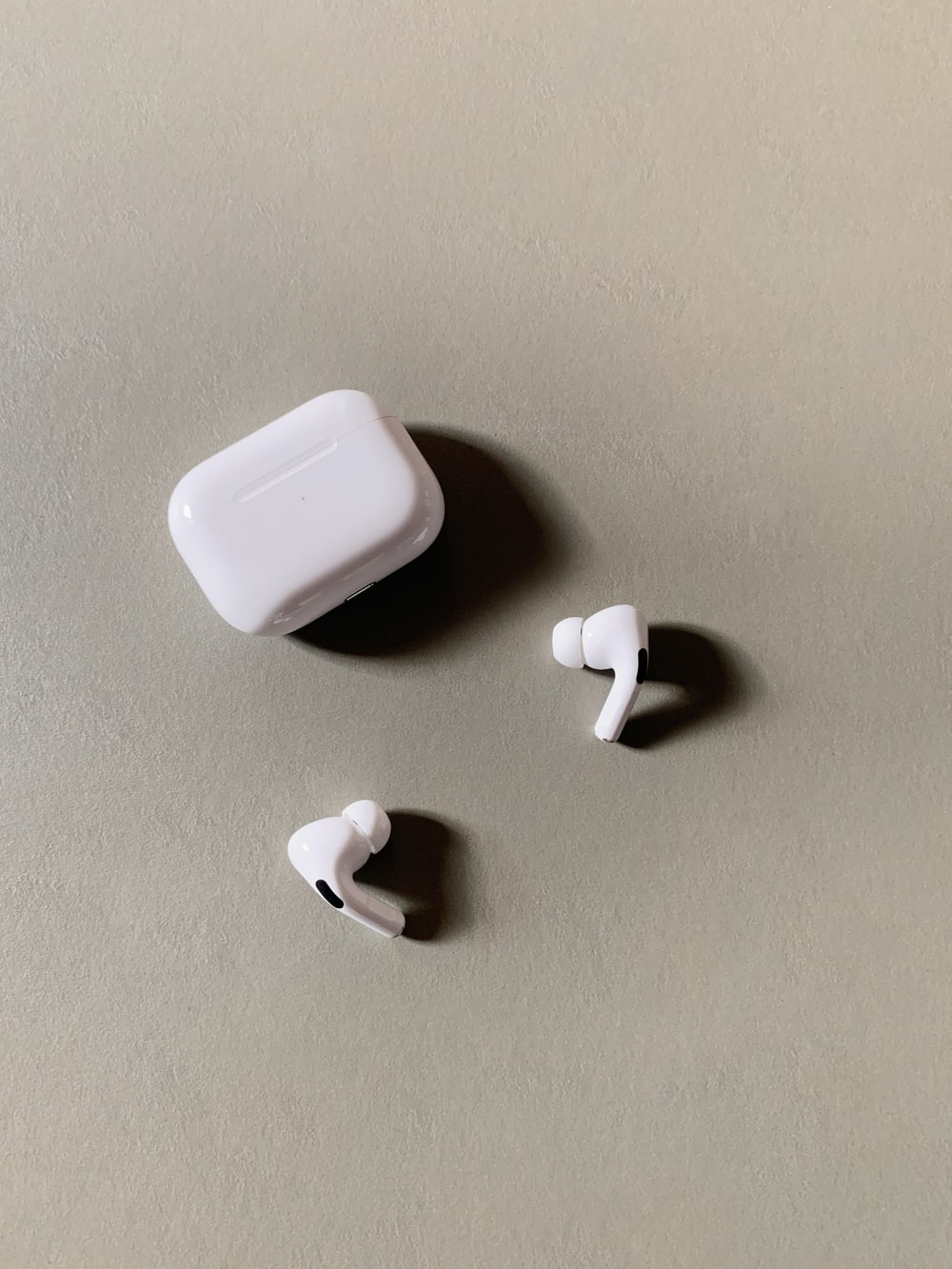 white wireless earbuds with charging case