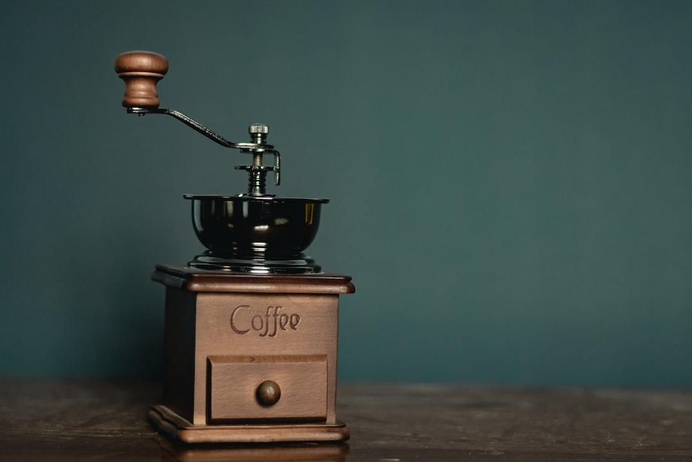 brown and black coffee grinder