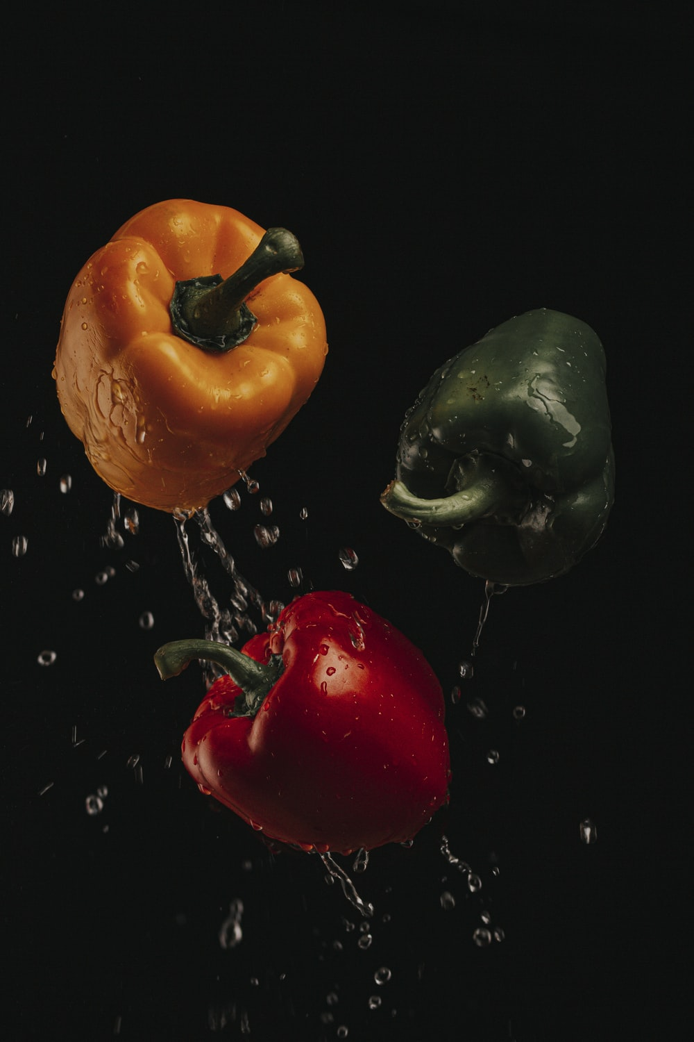 three assorted-color bell peppers