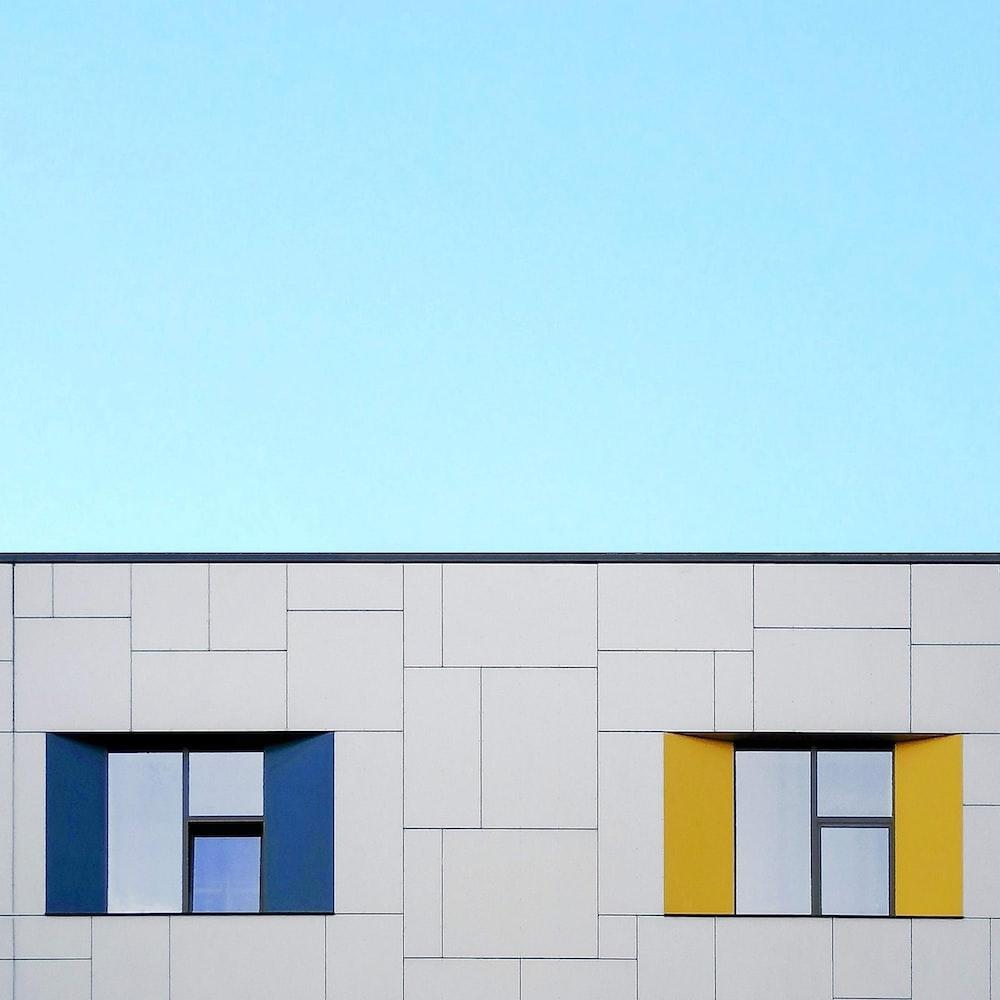 white concrete building under clear blue sky